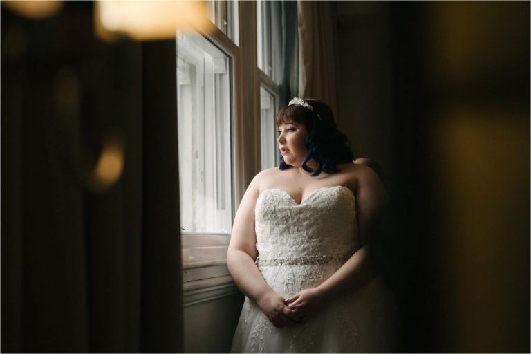 bride looking out of window about to get married