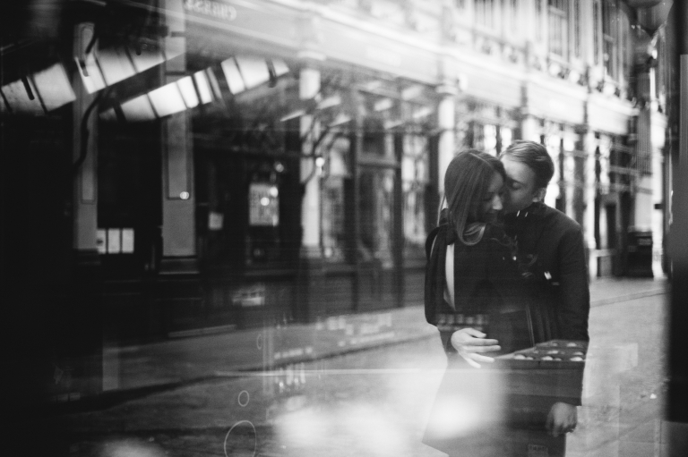 couple having a engagement photoshoot in London's leadenhall market