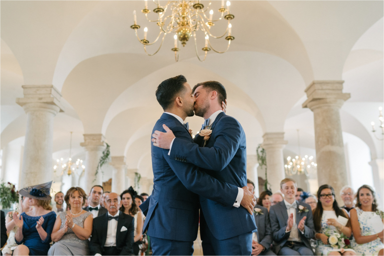 first kiss of a couple at a wedding