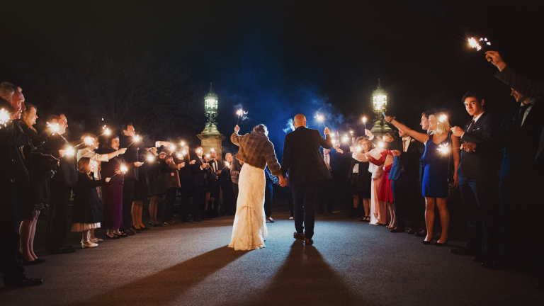 bride and groom exiting their wedding with sparklers