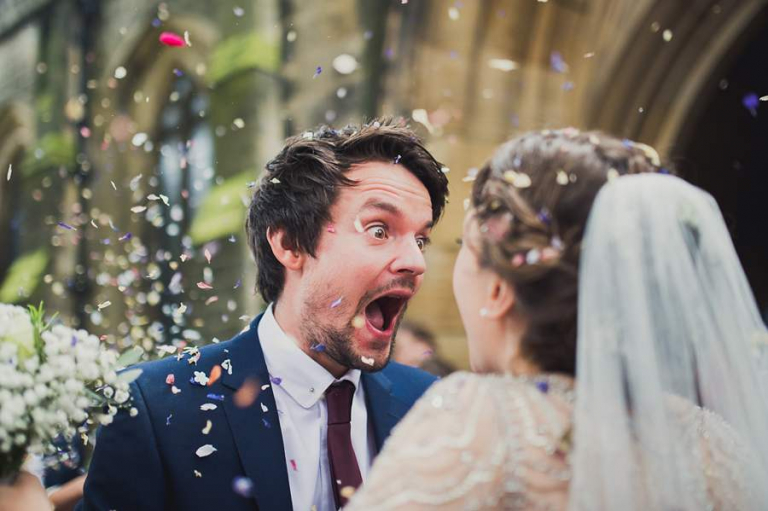 bride and groom excited about confetti on their wedding day